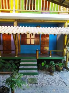 A porch or other outdoor area at Estalagem Itamambuca