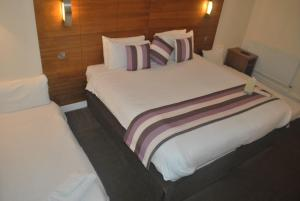 A bed or beds in a room at Legacy Preston International Hotel