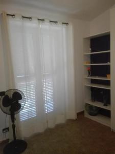 Area soggiorno di Santy's Rooms 2piano no lift no aria condizionata