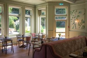 A restaurant or other place to eat at Worplesdon Place Hotel