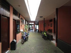 The lobby or reception area at Hotel Bakti