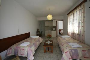 Ένα ή περισσότερα κρεβάτια σε δωμάτιο στο Gikas Apartments