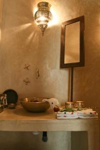 A bathroom at Riad Golfame