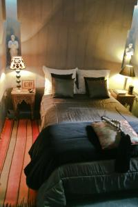 A bed or beds in a room at Riad Golfame