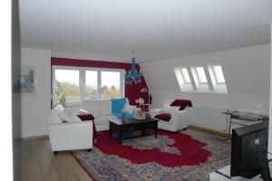 Ein Sitzbereich in der Unterkunft Ferienwohnung Bellaria