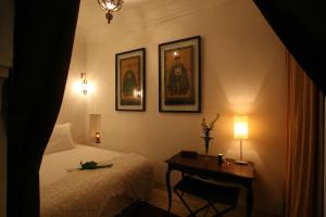 A bed or beds in a room at Riad dar thania