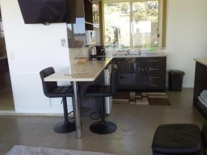 A kitchen or kitchenette at Pelican Point Sanctuary