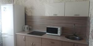 A kitchen or kitchenette at Апартаменты на ул. Жукова 11/1