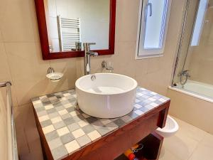 A bathroom at La Torre Golf Resort - 8307