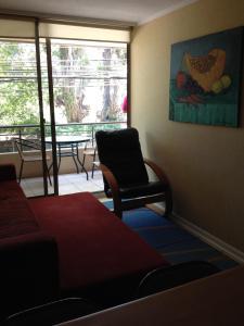 A seating area at Departamento Reñaca Torremolinos XII