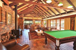 A pool table at Langbrook Cottages