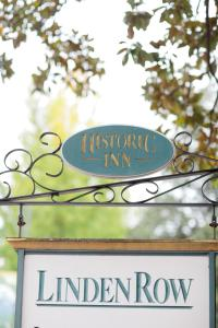 The logo or sign for the inn