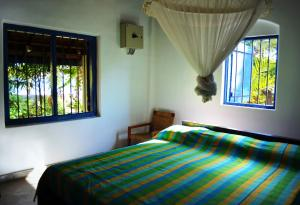 A bed or beds in a room at 15LMD Villa in Front of the Lagoon