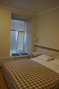 Кровать или кровати в номере Rusapart on Lenivka