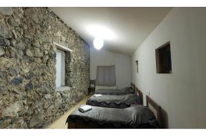 A bed or beds in a room at Villa Mestia Hotel