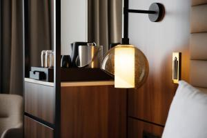 A kitchen or kitchenette at AC Hotel by Marriott Stockholm Ulriksdal