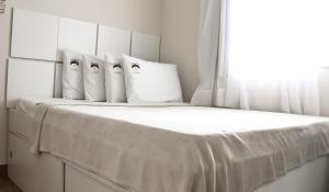 A bed or beds in a room at Boutique Hotel Casa Teatro