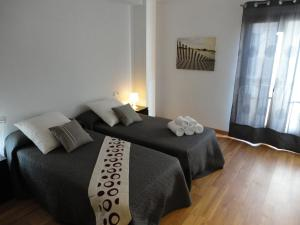 A bed or beds in a room at Residencial Suites Valldemossa - Turismo de Interior