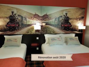 Un ou plusieurs lits dans un hébergement de l'établissement Hotel Victoria Lyon Perrache Confluence