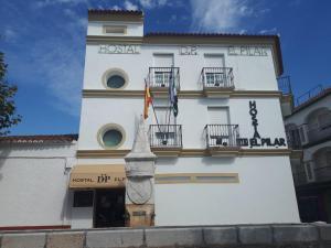 The facade or entrance of Hostal DP El Pilar