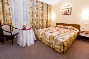 Кровать или кровати в номере Отель Ретро