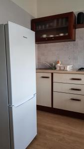 A kitchen or kitchenette at Old Kaunas Apartment