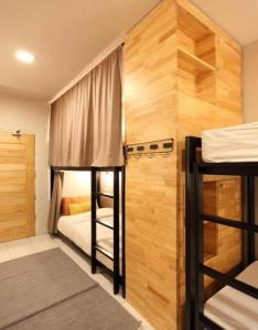 A bunk bed or bunk beds in a room at Lupta Hostel Patong Hideaway