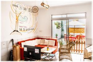 The lounge or bar area at ATMA Hostel & Yoga