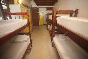 A bunk bed or bunk beds in a room at Biergarten Hostel