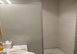 A bathroom at Holiday Inn Express Bengaluru Whitefield ITPL