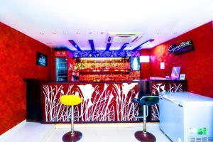 The lounge or bar area at Hotel Rajshree