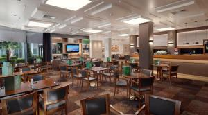 A restaurant or other place to eat at Holiday Inn Athens Attica Av, Airport W.