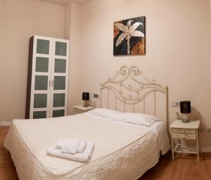 Cama o camas de una habitación en SEVITUR Seville Comfort Apartments