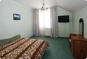 A bed or beds in a room at Edelweiss