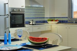 A kitchen or kitchenette at Danae Villas