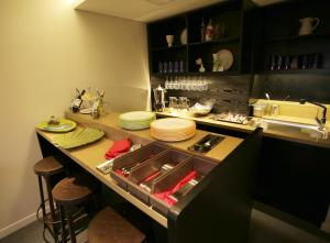 A kitchen or kitchenette at I.T.W Hotel