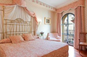 Cama o camas de una habitación en Hotel Doña María