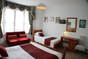 A bed or beds in a room at Filton Guest House