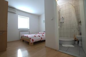 A bed or beds in a room at Guest House Ivac Inn Zagreb Airport