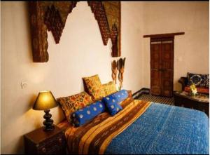 A bed or beds in a room at Riad Idrissy