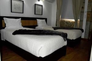 A bed or beds in a room at Quinta do Olival