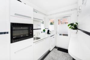 Kuchyň nebo kuchyňský kout v ubytování Lightotel Eindhoven