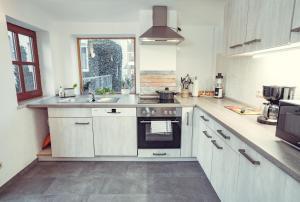Küche/Küchenzeile in der Unterkunft Auberge Leipzig