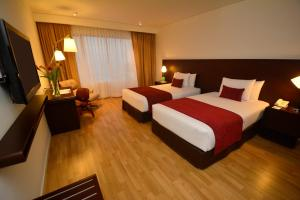 A bed or beds in a room at Dazzler by Wyndham Lima Miraflores