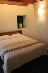Cama ou camas em um quarto em Casa de Almagreira