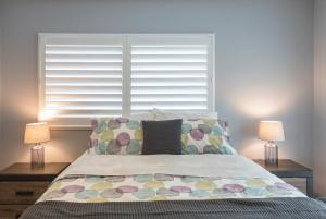 A bed or beds in a room at Salt and Sand Vacation Cottages