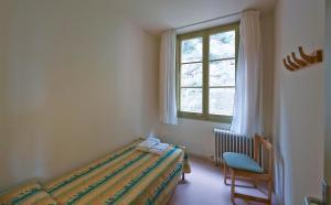 A bed or beds in a room at Apartamentos Montserrat Abat Marcet