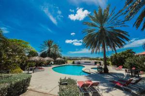A piscina localizada em Ocean View 20 - Blue Bay ou nos arredores