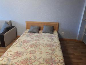 Кровать или кровати в номере Абсолют