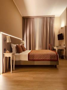 A bed or beds in a room at Hotel Villa Malpensa